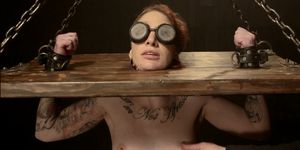 Blindfolded Slave Is Locked In Stocks