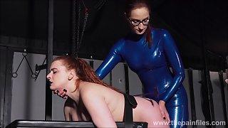 Mistress In Latex Katarina Spanks Slave Isabel Dean